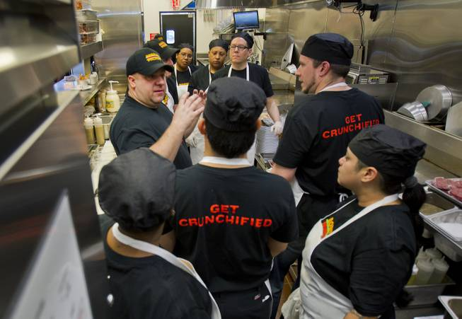 Director of Operations Michael Kuhns briefs his kitchen staff as they ready to prepare lunch for guests after the ribbon-cutting ceremony of chef Bobby Flay's Bobby's Burger Palace on Wednesday, Jan. 29, 2014, on the Strip in Las Vegas.