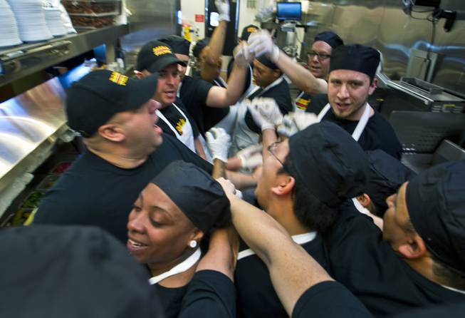 Director of Operations Michael Kuhns with his kitchen staff as they prepare lunch for invited guests after the ribbon-cutting ceremony of chef Bobby Flay's Bobby's Burger Palace on Wednesday, Jan. 29, 2014, on the Strip in Las Vegas.