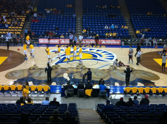 UNLV and San Jose State players warm up on the court before the teams' game on Wednesday, Jan. 29, 2014, at the Events Center in San Jose, Calif.