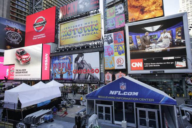 An information tent, lower right, is in place for Super Bowl Boulevard in New York's Times Square, Tuesday, Jan. 28, 2014. Thirteen blocks of midtown Manhattan have been converted into a temporary festival space leading up to the National Football League's championship game between the Seattle Seahawks and the Denver Broncos on Sunday, Feb. 2, in East Rutherford, N.J.