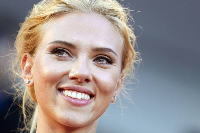 "Actress Scarlett Johansson poses for photographers on the red carpet for the screening of the film ""Under The Skin"" at the 70th edition of the Venice Film Festival in Venice, Italy, Sept. 3, 2013."