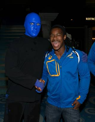South Africa rugby player Branco du Preez meets Blue Man Group at Monte Carlo Wednesday, Jan. 29, 2014.