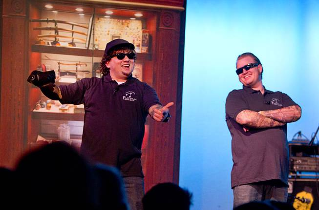 "Garrett Grant, left, as Chump and Gus Langley as Lil' Boss perform during ""Pawn Shop Live!"" at the Golden Nugget Thursday, Jan. 30, 2014. The production show is a parody based on the story of Gold & Silver Pawn, home of the History Channel's Pawn Stars television series."