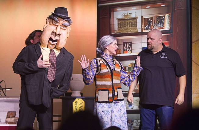 "Old Fart (Enoch Scott), left, and Slick Garrison (Sean Critchfield), right talk with a school teacher (Anita Bean)during a performance of ""Pawn Shop Live!"" at the Golden Nugget Thursday, Jan. 30, 2014. The production show is a parody based on the story of Gold & Silver Pawn, home of the History Channel's Pawn Stars television series."
