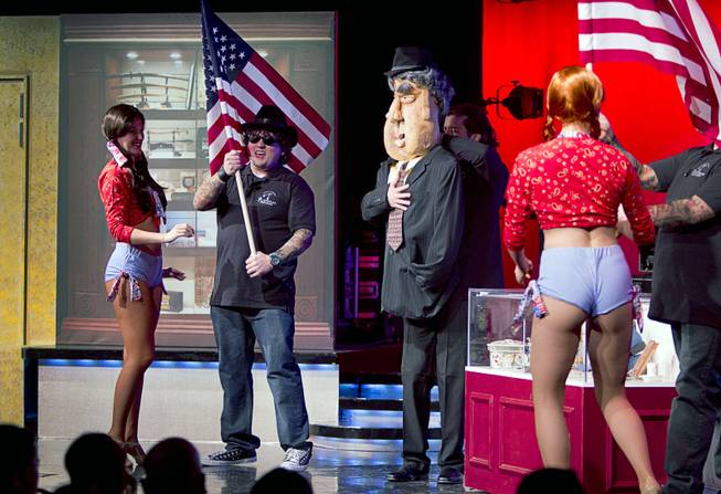 "A patriotic scene is shown during a performance of ""Pawn Shop Live!"" at the Golden Nugget Thursday, Jan. 30, 2014. The production show is a parody based on the story of Gold & Silver Pawn, home of the History Channel's Pawn Stars television series."