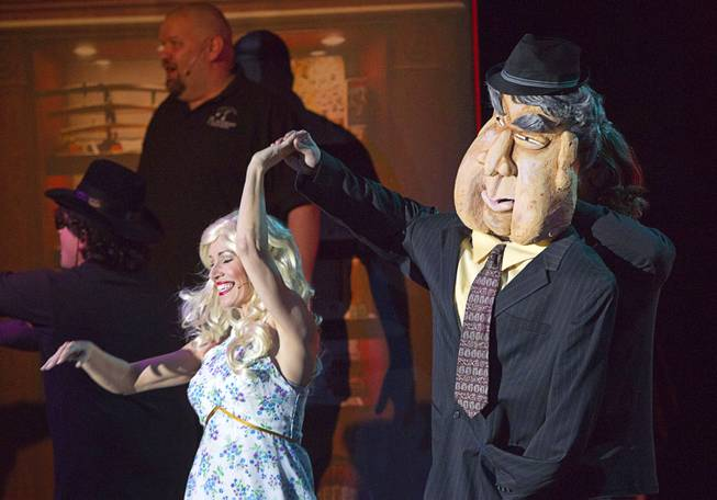 "Old Fart (Enoch Scott) dances with his wife (Anita Bean) during a performance of ""Pawn Shop Live!"" at the Golden Nugget Thursday, Jan. 30, 2014. The production show is a parody based on the story of Gold & Silver Pawn, home of the History Channel's Pawn Stars television series."