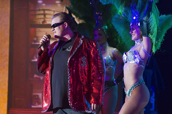 "Lil' Boss (Gus Langley) performs with showgirls during a performance of ""Pawn Shop Live!"" at the Golden Nugget Thursday, Jan. 30, 2014. The production show is a parody based on the story of Gold & Silver Pawn, home of the History Channel's Pawn Stars television series."