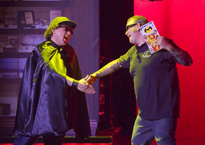 "Chump (Garrett Grant), left, and Lil' Boss (Gus Langley), meet for the first time during ""Pawn Shop Live!"" at the Golden Nugget Thursday, Jan. 30, 2014. The production show is a parody based on the story of Gold & Silver Pawn, home of the History Channel's Pawn Stars television series."