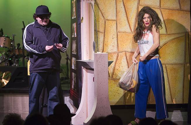 "Chump (Garrett Grant), left, gets a customer at the night window during a performance of ""Pawn Shop Live!"" at the Golden Nugget Thursday, Jan. 30, 2014. The production show is a parody based on the story of Gold & Silver Pawn, home of the History Channel's Pawn Stars television series."