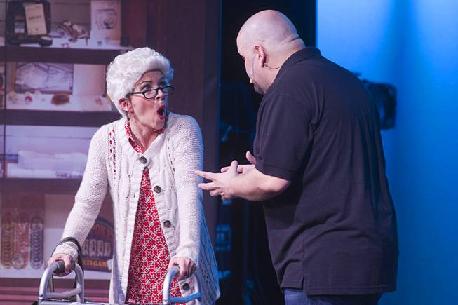 "A customer reacts as Slick Garrison (Sean Critchfield) tells her the value of her item during a performance of ""Pawn Shop Live!"" at the Golden Nugget Thursday, Jan. 30, 2014. The production show is a parody based on the story of Gold & Silver Pawn, home of the History Channel's Pawn Stars television series."