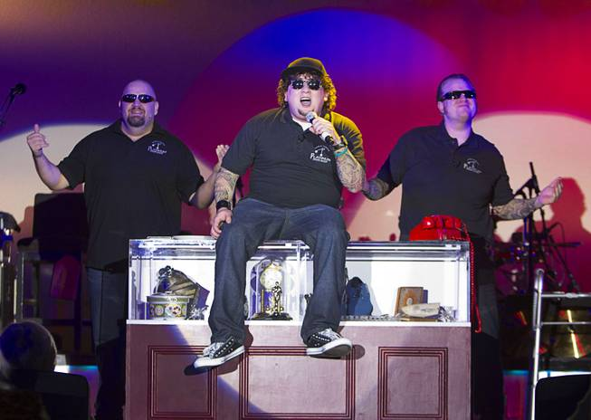 "Slick Garrison (Sean Critchfield), left, Chump (Garrett Grant), center, and Lil' Boss (Gus Langley) perform during ""Pawn Shop Live!"" at the Golden Nugget Thursday, Jan. 30, 2014. The production show is a parody based on the story of Gold & Silver Pawn, home of the History Channel's Pawn Stars television series."