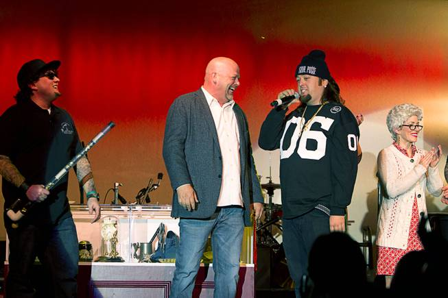 "Rick Harrison, left, and Austin ""Chumlee"" Russell join cast members on stage after a performance of ""Pawn Shop Live!"" at the Golden Nugget Thursday, Jan. 30, 2014. The production show is a parody based on the story of Gold & Silver Pawn, home of the History Channel's Pawn Stars television series."