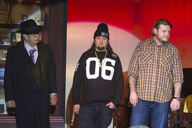 "Richard ""The Old Man"" Harrison, left, Austin ""Chumlee"" Russell, center, and Corey ""Big Hoss"" Harrison are shown on stage after a performance of ""Pawn Shop Live!"" at the Golden Nugget Thursday, Jan. 30, 2014. The production show is a parody based on the story of Gold & Silver Pawn, home of the History Channel's Pawn Stars television series."