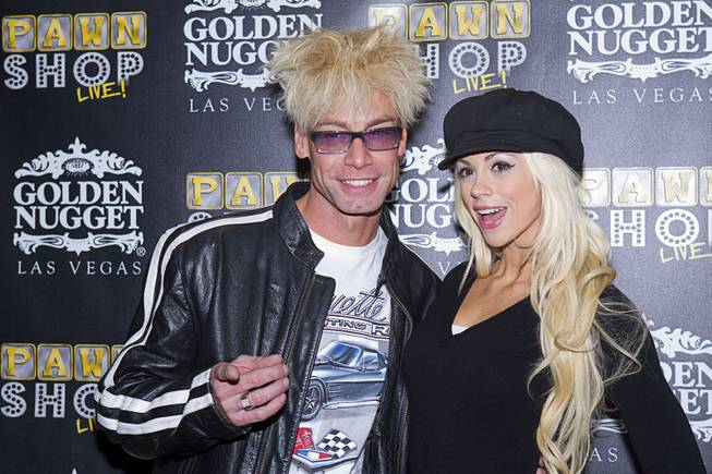 "Magician/comedian Murray SawChuck, left, and his wife, entertainer Chloe Louise Crawford pose on the red carpet after a performance of ""Pawn Shop Live!"" at the Golden Nugget Thursday, Jan. 30, 2014. The production show is a parody based on the story of Gold & Silver Pawn, home of the History Channel's Pawn Stars television series."