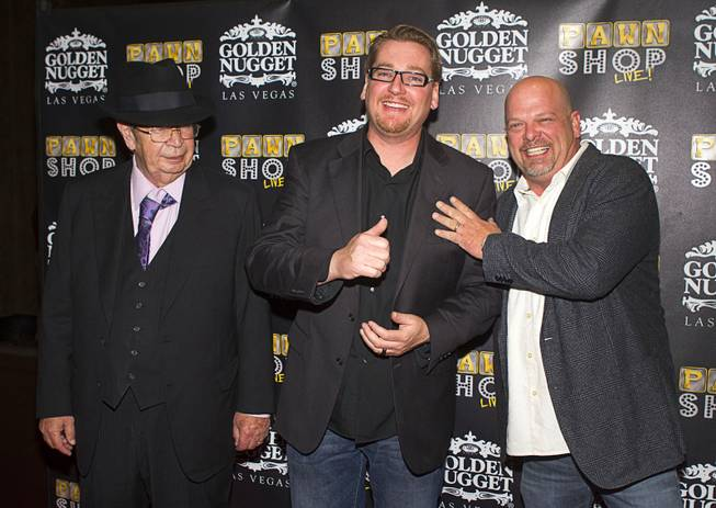 "Richard ""The Old Man"" Harrison, left, Derek Stonebarger, center,and Rick Harrison pose on the red carpet after attending a performance of ""Pawn Shop Live!"" at the Golden Nugget Thursday, Jan. 30, 2014. The production show is a parody based on the story of Gold & Silver Pawn, home of the History Channel's Pawn Stars television series. Stonebarger is the co-writer and producer of the show."