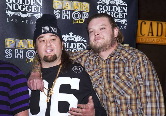"Austin ""Chumlee"" Russell, left, and Corey ""Big Hoss"" Harrison pose on the red carpet after attending a performance of ""Pawn Shop Live!"" at the Golden Nugget Thursday, Jan. 30, 2014. The production show is a parody based on the story of Gold & Silver Pawn, home of the History Channel's Pawn Stars television series."