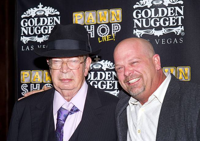 "Richard ""The Old Man"" Harrison and his son Rick Harrison arrive on the red carpet after a performance of ""Pawn Shop Live!"" on Thursday, Jan. 30, 2014, at Golden Nugget in downtown Las Vegas."