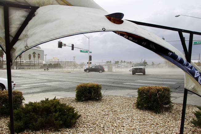 Wind blows dirt off a lot at the intersection of Main Street and Wyoming Avenue as a weather system moves through the valley Thursday, Jan. 30, 2014.
