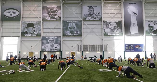 Denver Broncos players stretch during practice at the New York Jets facility Thursday, Jan. 30, 2014, in Florham Park, N.J. The Broncos are scheduled to play the Seattle Seahawks in the NFL Super Bowl XLVIII football game Sunday, Feb. 2, in East Rutherford, N.J.