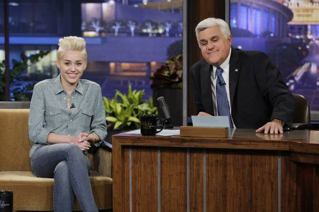 "This Jan. 30, 2014, photo provided by NBC shows Miley Cyrus, left, during an interview with host Jay Leno, on ""The Tonight Show with Jay Leno."" Leno, who took over the ""Tonight Show"" in 1992, will host his final episode on Thursday, Feb. 6, 2014. (AP Photo/NBC, Paul Drinkwater)"