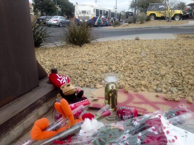 Vehicles and pedestrians travel past a makeshift memorial on Tropicana Avenue at Rainbow Boulevard. The memorial marks the spot where Cleottus Harvey was gunned down by a fellow motorist on Jan. 21. Police are urging witnesses to come forward with information about the shooting.
