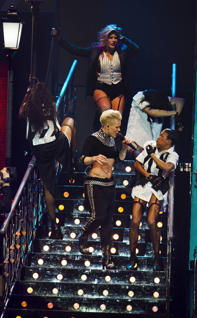 Pink performs about her dancers in front of a packed house at the MGM Grand Garden Arena on Friday, Jan. 31, 2014.