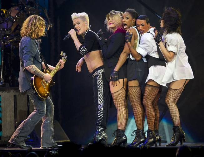Pink performs with her dancers and guitarist Justin Derrico in front of a packed house at the MGM Grand Garden Arena on Friday, Jan. 31, 2014.