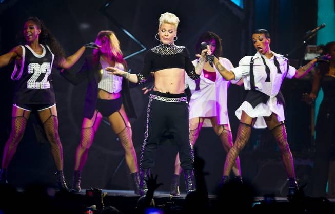 "Pink performs with her dancers during ""The Truth About Love Tour"" concert Friday, Jan. 31, 2014, at MGM Grand Garden Arena."