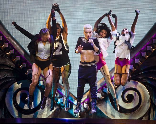 Pink gets up in the air with her dancers in front of a packed house at the MGM Grand Garden Arena on Friday, Jan. 31, 2014.