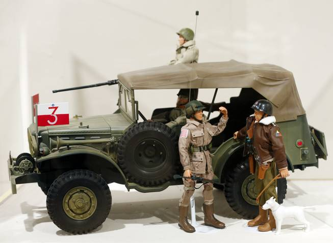 This Jan. 31, 2014, photo shows a Gen. George Patton G.I. Joe action figure, right, and other G.I. Joes in a display at the New York State Military Museum  in Saratoga Springs, N.Y. A half-century after the 12-inch doll was introduced at a New York City toy fair, the iconic action figure is being celebrated by collectors with a display at the military museum, while the toy's maker plans other anniversary events to be announced later this month.