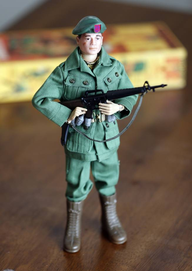 This Jan. 31, 2014, photo shows one of Tearle Ashby's G.I. Joe action figures in Niskayuna, N.Y. A half-century after the 12-inch doll was introduced at a New York City toy fair, the iconic action figure is being celebrated by collectors with a display at the New York State Military Museum, while the toy's maker plans other anniversary events to be announced later this month.