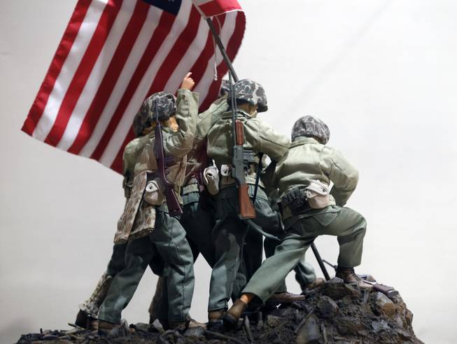 In this Jan. 31, 2014, photo, G.I. Joe action figures portray Raising the Flag on Iwo Jima in a display at the New York State Military Museum in Saratoga Springs, N.Y. A half-century after the 12-inch doll was introduced at a New York City toy fair, the iconic action figure is being celebrated by collectors with a display at the military museum, while the toy's maker plans other anniversary events to be announced later this month.