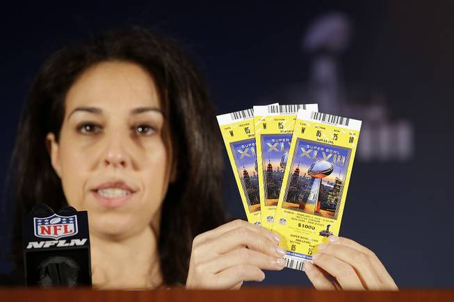 Anastasia Danias, with the NFL, speaks about the security features of Super Bowl XLVIII tickets during a news conference on counterfeit merchandise at the NFL Super Bowl XLVIII media center, Thursday, Jan. 30, 2014, in New York.