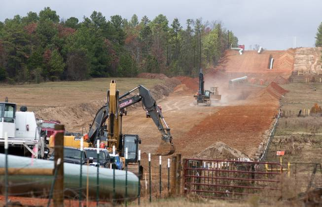 In this Dec. 3, 2012, file photo, crews work on construction of the TransCanada Keystone XL Pipeline near County Road 363 and County Road 357, east of Winona, Texas.