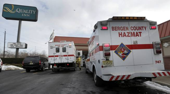 Emergency vehicles are parked outside a Quality Inn near the site of NFL Super Bowl XLVIII, Friday, Jan. 31, 2014, in Lyndhurst, N.J. White powder was mailed to businesses near the site of Sunday's Super Bowl, prompting an investigation by the FBI and other law enforcement.