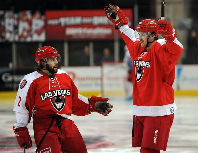 Las Vegas Wranglers center Justin Bernhardt, right, celebrates with teammate Nick Wheeler (2) after scoring his second goal of the game against the Ontario Reign on Friday night.