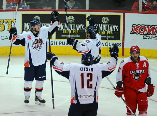 Ontario Reign left winger Riley Brace, left, celebrates after scoring a third period goal against the Las Vegas Wranglers on Saturday night at the Orleans Arena.