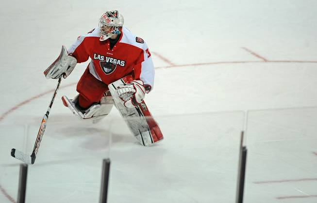 Down two goals to the Ontario Reign, Las Vegas Wranglers goaltender Travis Fullerton leaves the Las Vegas net late in the third period to substitute for an extra attacker.