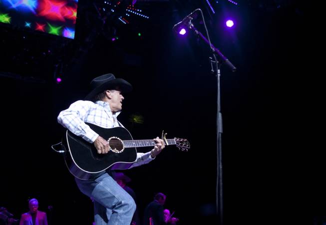 "George Strait performs during his ""The Cowboy Rides Away Tour"" stop at MGM Grand Garden Arena on Saturday, Feb. 1, 2014."
