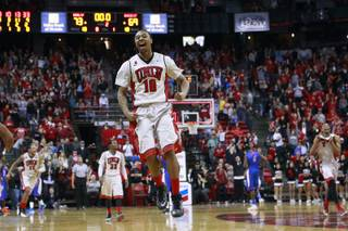 UNLV guard Daquan Cook leaps as time runs out in their Mountain West Conference game against Boise State Saturday, Feb. 1, 2014 at the Thomas & Mack Center. UNLV notched a 73-69 come from behind victory.
