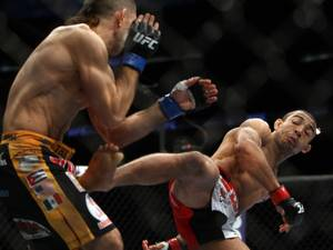 Jose Aldo, right, of Brazil and Ricardo Lamas of Chicago, IL fight in the first round of the Ultimate Fighting Featherweight Championship Mix Martial Arts bout in Newark, N.J. on Saturday, Feb. 1, 2014. Aldo won by unanimous decision in five rounds. (AP Photo/Tim Larsen)