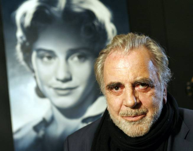 "In this Jan. 30, 2007, file picture, actor Maximilian Schell poses in front of a poster of his sister Maria Schell in Frankfurt, Germany. Austrian actor Maximilian Schell, who won the best actor Oscar in the early 1960s for his portrayal of a defense attorney in the drama ""Judgment at Nuremberg,"" has died. He was 83."
