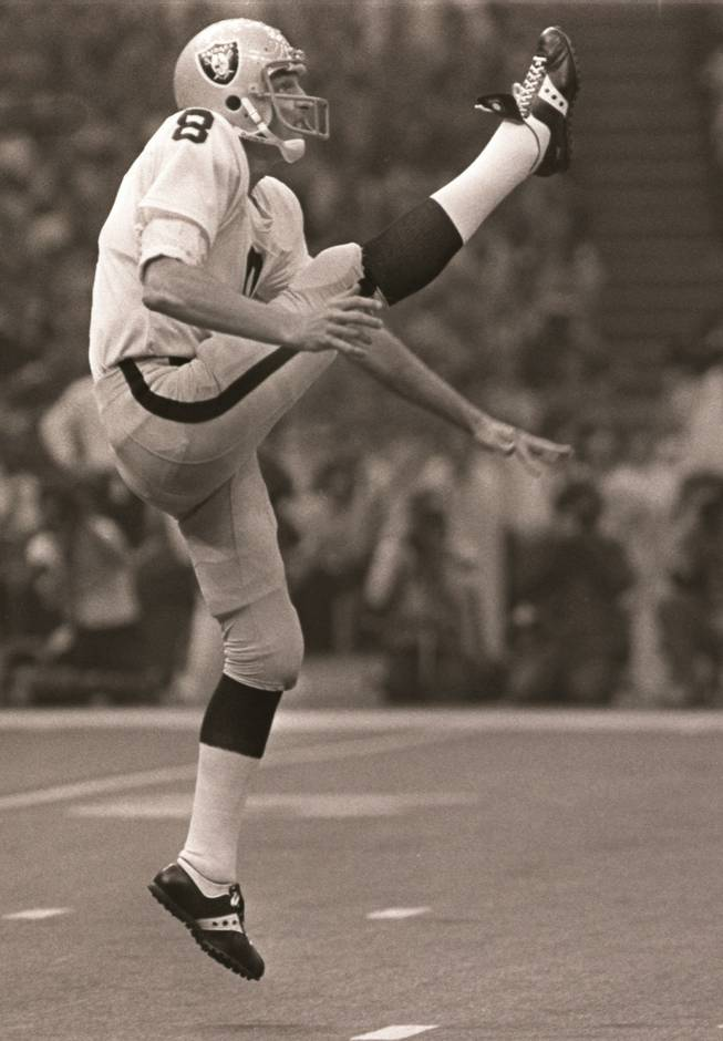 In this Jan. 25, 1981, file photo, Oakland Raiders punter Ray Guy kicks during the Super Bowl in New Orleans. Guy has become the first punter elected to the Pro Football Hall of Fame on Saturday Feb. 1, 2014.