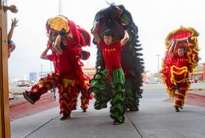 Lion dancers perform outside the Kung Fu Thai & Chinese Restaurant, 3505 S. Valley View Blvd. Sunday, Feb. 2, 2014. The traditional ceremony, performed by the Lohan School of Shaolin, was staged to drive out any evil spirits from the business.