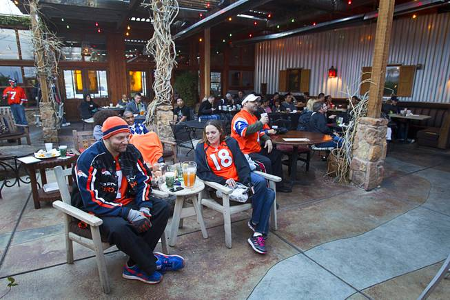 Denver Broncos fans watch Super Bowl XLVIII from an outdoor patio at the Roadrunner Saloon, 9820 W. Flamingo Rd., Sunday, Feb. 2, 2014.