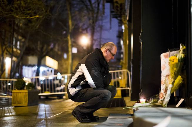 "A man pays his respects outside of the apartment complex of Philip Seymour Hoffman, Sunday, Feb. 2, 2014, in New York. Hoffman, who won an Oscar for best actor in 2006 for his portrayal of writer Truman Capote in ""Capote"", was found dead Sunday in his apartment. He was 46."