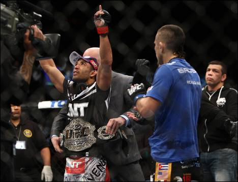 Jose Aldo, left, of Brazil celebrates after beating Ricardo Lamas of Chicago in five rounds of the Ultimate Fighting featherweight championship bout in Newark, N.J., on Saturday, Feb. 1, 2014. Aldo won by unanimous decision.