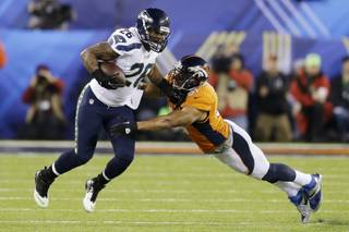Seattle Seahawks' Michael Robinson tries to get past Denver Broncos' Paris Lenon during the first half of the NFL Super Bowl XLVIII football game Sunday, Feb. 2, 2014, in East Rutherford, N.J. (AP Photo/Ben Margot)