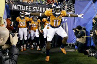 Denver Broncos' Trindon Holliday and takes the field before the NFL Super Bowl XLVIII football game against the Seattle Seahawks Sunday, Feb. 2, 2014, in East Rutherford, N.J. (AP Photo/Mark Humphrey)