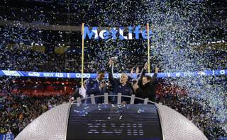 Seattle Seahawks head coach Pete Carroll holds the Vince Lombardi Trophy as he celebrates after the NFL Super Bowl XLVIII football game against the Denver Broncos Sunday, Feb. 2, 2014, in East Rutherford, N.J. The Seahawks won 43-8. (AP Photo/Matt Slocum)